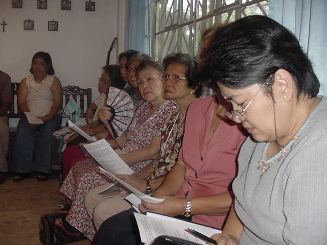Charismatic prayer group meeting